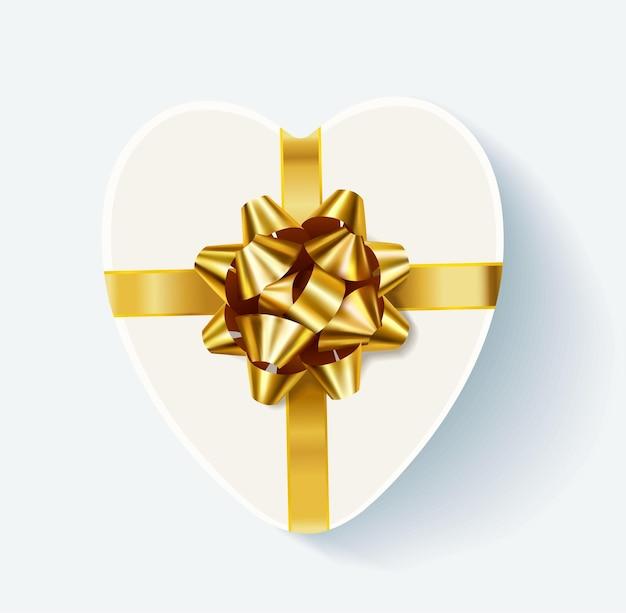 Scatola regalo bianca a forma di cuore con fiocco dorato