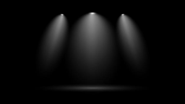 Faretto a fascio di luce bianca su sfondo nero per la decorazione di scene teatrali e in studio
