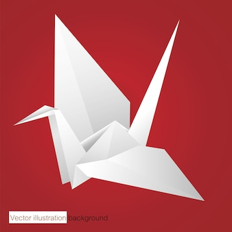 Uccello di carta bianca su sfondo rosso