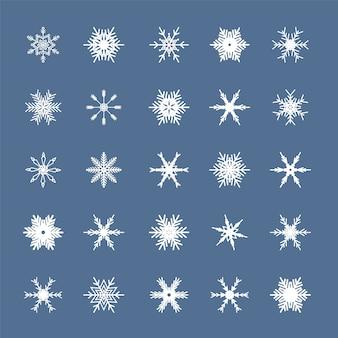Set di fiocchi di neve bianchi isolato su sfondo blu.