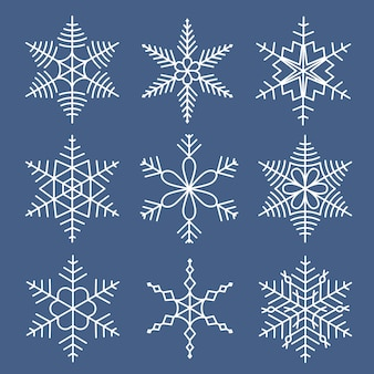 Set di fiocchi di neve bianchi isolati per il design di natale