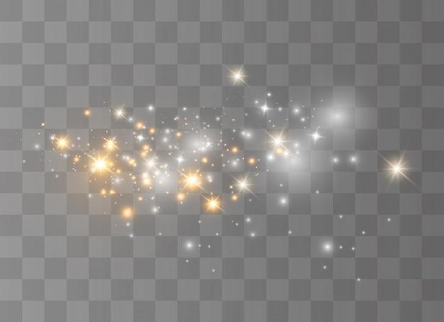 Scintille bianche scintillano effetto luce speciale. brilla su sfondo trasparente. estratto di natale. particelle di polvere magica scintillante