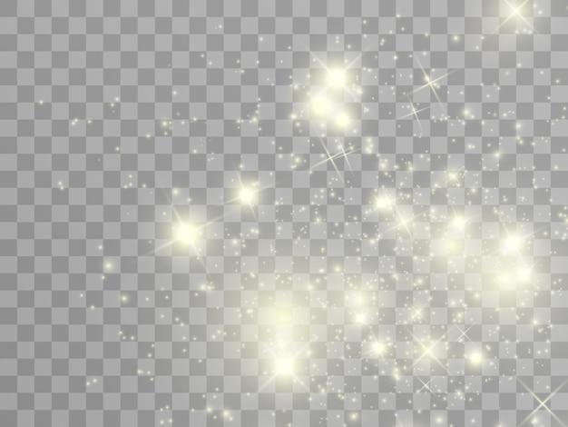 Scintille bianche e stelle dorate scintillano con un effetto di luce speciale. brilla su sfondo trasparente. modello astratto di natale. scintillanti particelle di polvere magica