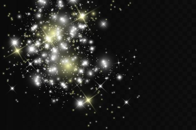 Scintille bianche e stelle dorate scintillano con un effetto di luce speciale. brilla su sfondo trasparente.