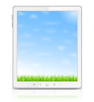 Tablet pc bianco con erba verde e cielo blu sullo schermo