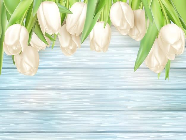 Tulipani bianchi sul retro in legno turchese.