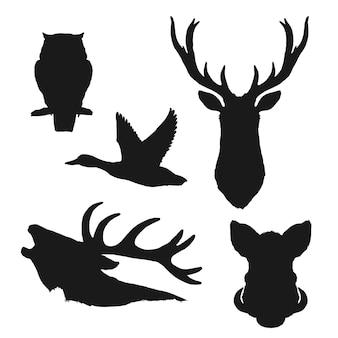 Siluette nere isolate dell'uccello e dell'animale selvatico