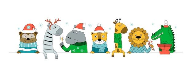 Animali selvaggi con regali, caramelle e stelle filanti. natale con zebre, scimmie, giraffe, coccodrilli, tigri, leoni, ippopotami.