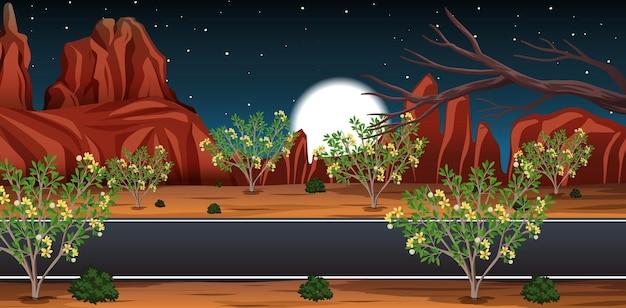 Deserto selvaggio con una lunga strada paesaggio di scena notturna