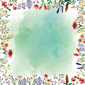 Cornice dell'acquerello di fiori selvatici con sfondo verde acquerello