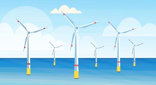 I generatori eolici puliscono l'orizzontale del fondo di vista sul mare di concetto della stazione dell'acqua rinnovabile di fonte di energia alternativa
