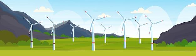 Insegna orizzontale pulita del fondo naturale delle montagne del paesaggio di concetto della stazione rinnovabile pulita di fonte di energia alternativa del campo delle turbine eoliche