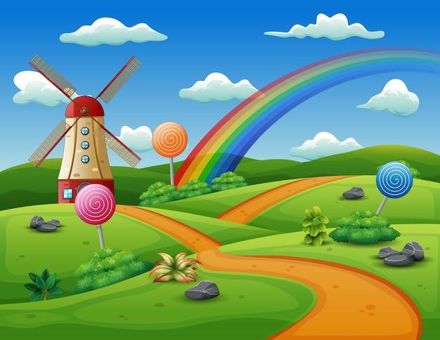 Un mulino a vento e caramelle su uno sfondo di natura