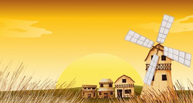 Mulino a vento nel fondo giallo di scena dell'azienda agricola