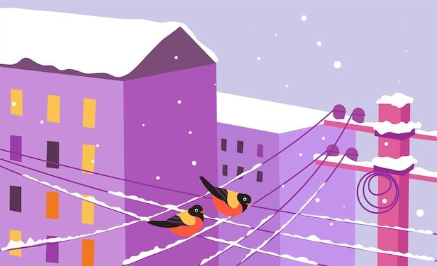 Edifici e fili del paesaggio urbano invernale con uccelli