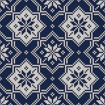 Motivo a maglia winter fair isle. design maglione lavorato a maglia Vettore Premium