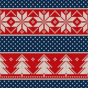 Motivo a maglia per vacanze invernali con fiocchi di neve e ornamento di alberi di natale