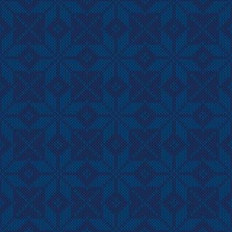 Vacanze invernali motivo a maglia con fiocchi di neve ornamento vettore sfondo senza giunture con sfumature di blu