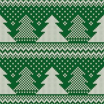 Reticolo di lavoro a maglia senza giunte di vacanza invernale con alberi di natale. maglione lavorato a maglia Vettore Premium