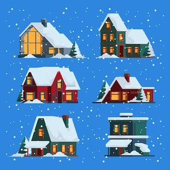 Case d'inverno. natale carino edifici in legno cottage con berretto da neve illustrazioni piatte colorate vettoriali. costruzione in legno inverno, campagna tetto natalizio