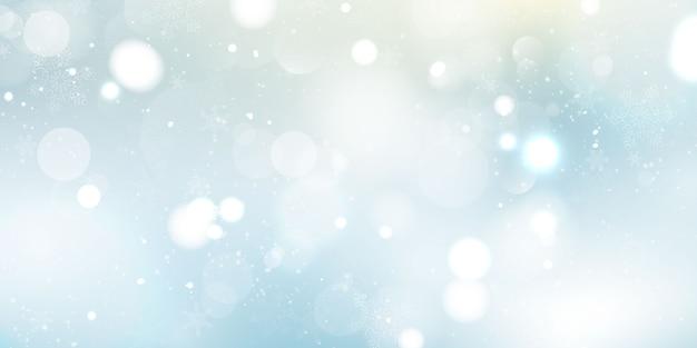 L'inverno è un elemento di luce sfocatura astratta che può essere utilizzato per lo sfondo decorativo bokeh. neve che cade