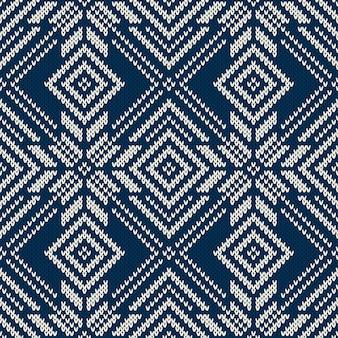 Motivo a maglia invernale con fiocchi di neve. sfondo senza soluzione di continuità