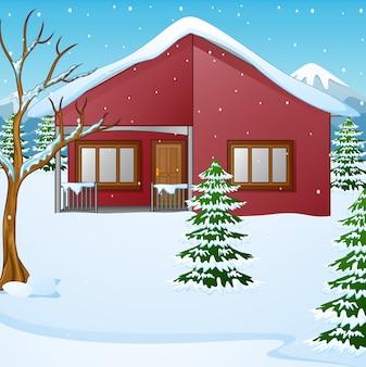 Paesaggio invernale con casa innevata e abete