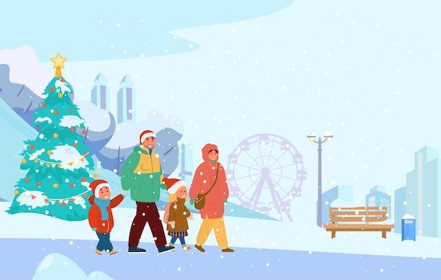 Paesaggio del parco invernale con la famiglia felice in cappelli di babbo natale che cammina