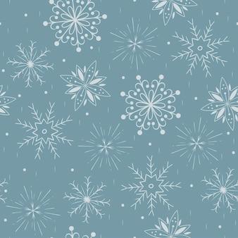 Modello senza cuciture invernale con fiocchi di neve