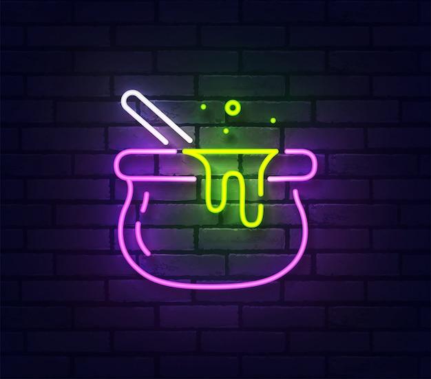 Insegna al neon della bombetta delle streghe. insegna luminosa della luce al neon isolata sul muro di mattoni.
