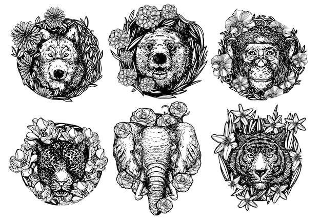 Lupo orso scimmia tigre ed elefante in fiore disegno a mano e schizzo in bianco e nero