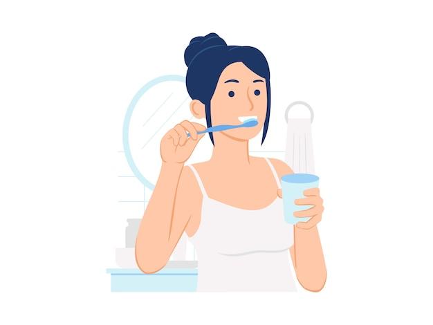Donna in bagno lavarsi i denti e in possesso di un bicchiere di acqua concetto illustrazione