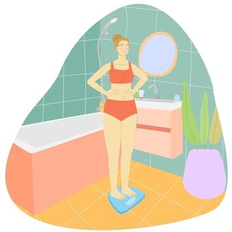 Donna in bagno sulla bilancia da pavimento ragazza in un asciugamano in bagno interno del bagno
