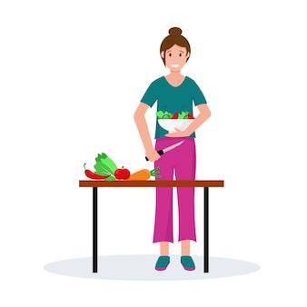 Donna che cucina insalata in cucina. casalinga a casa. progettazione del concetto di famiglia.