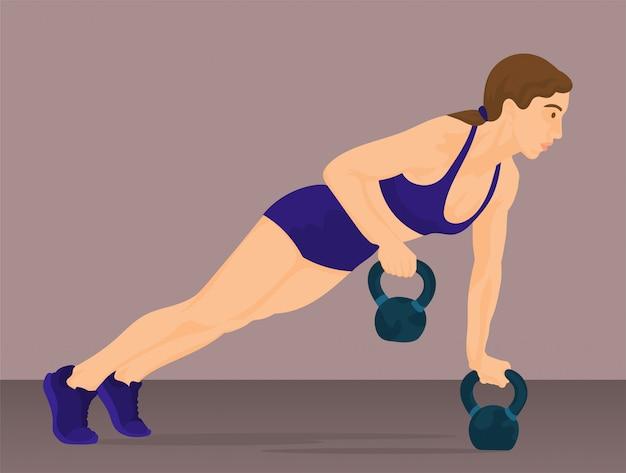 La donna che fa push up con kettlebell