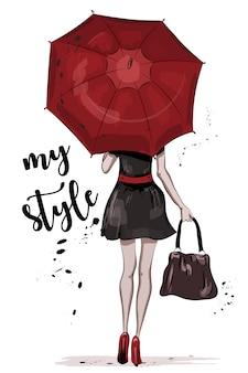 Donna in vestito con l'ombrello rosso.