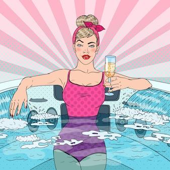 Donna che beve champagne nella vasca idromassaggio