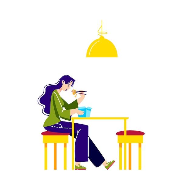 Donna che mangia tagliatelle, udon o ramen con le bacchette dalla scatola di carta per cibo di strada da asporto
