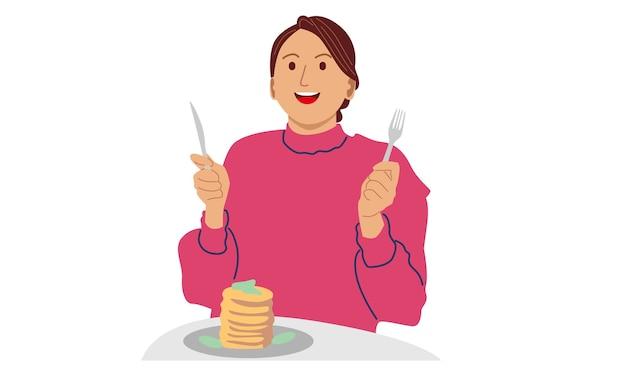 Donna che mangia frittelle per colazione