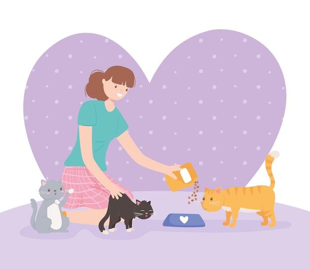 Donna che allatta i gatti