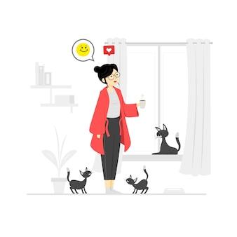 Donna che prende il caffè con i gatti