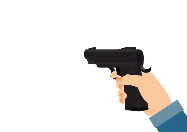 Mano della donna che tiene la pistola isolata su priorità bassa bianca.