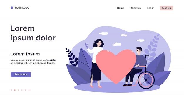 Donna e uomo handicappato che tiene grande cuore