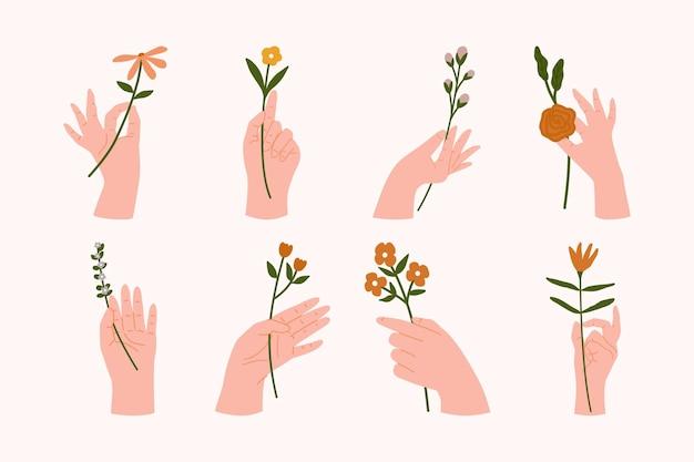 Mani della donna in diversi gesti che tengono mazzi o mazzi di fiori che sbocciano piatti