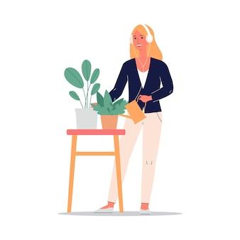 Donna in cuffie che innaffia l'illustrazione piana delle piante d'appartamento