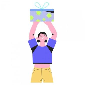 Una donna detiene un regalo o un regalo o vince un premio.