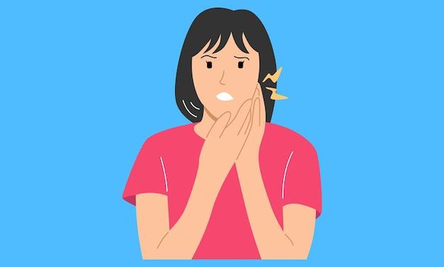 Donna che si tiene la guancia soffre di mal di denti