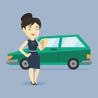 Chiavi della tenuta della donna alla sua nuova automobile.