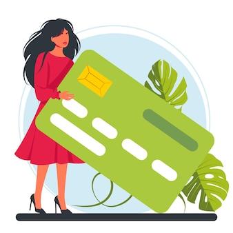 Donna che tiene in mano una grande carta di credito. personaggio di successo felice con un bankkarte. benessere finanziario. investimento aziendale e risparmio di denaro. tasse e finanziamenti. illustrazione vettoriale