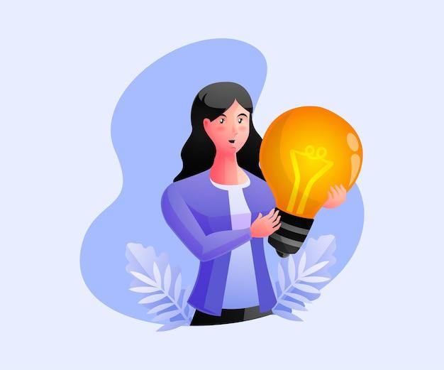 Una donna che tiene una lampadina